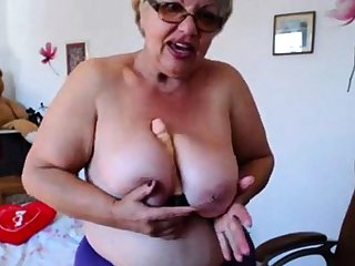 Granny playing with  big boobs primarily webcam! Amateur!